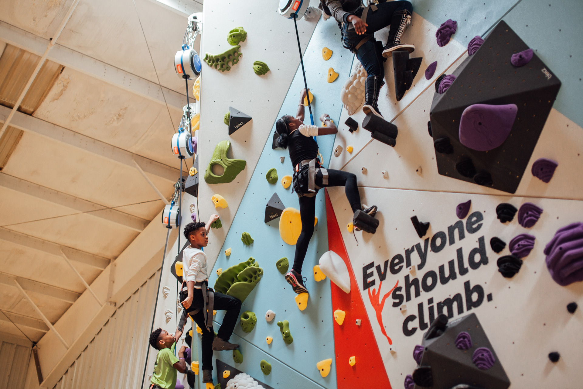 Everyone should climb - boys and girls club members try climbing for the first time.