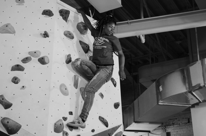 A Boys and Girls Club of Chicago member climbs at First Ascent in Chicago.