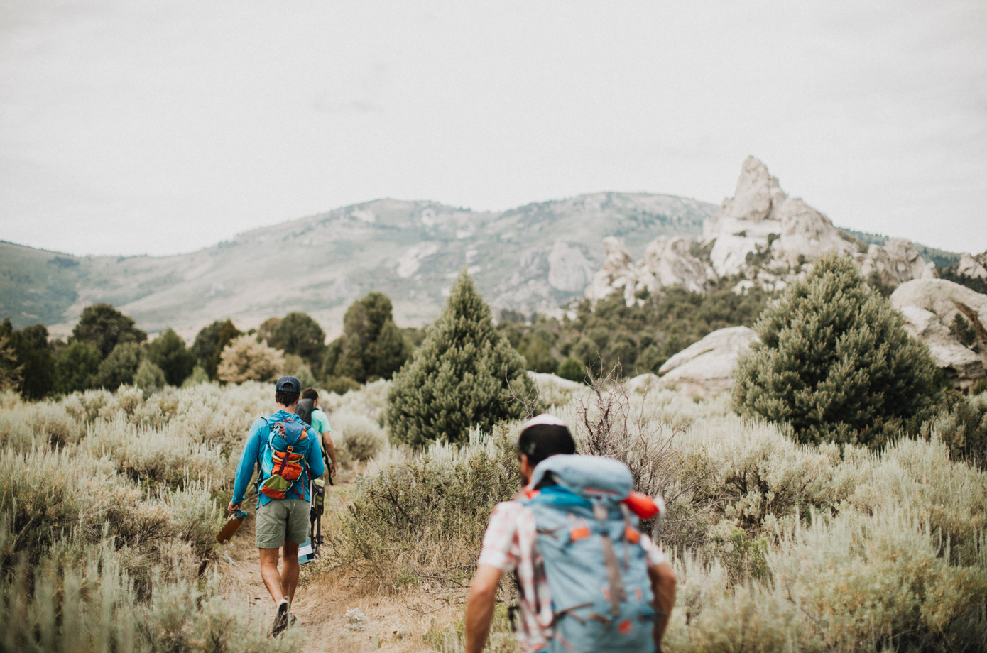 Kevin Jorgeson, Blake Mycoskie, and a guide approach at City of Rocks