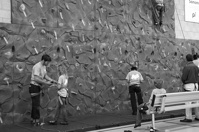 Boys and Girls Club of Sonoma members climb on the new climbing wall in their clubhouse.