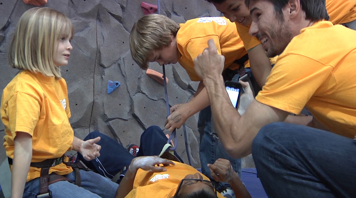 Kevin Jorgeson chats with Boys and Girls Club members about climbing.