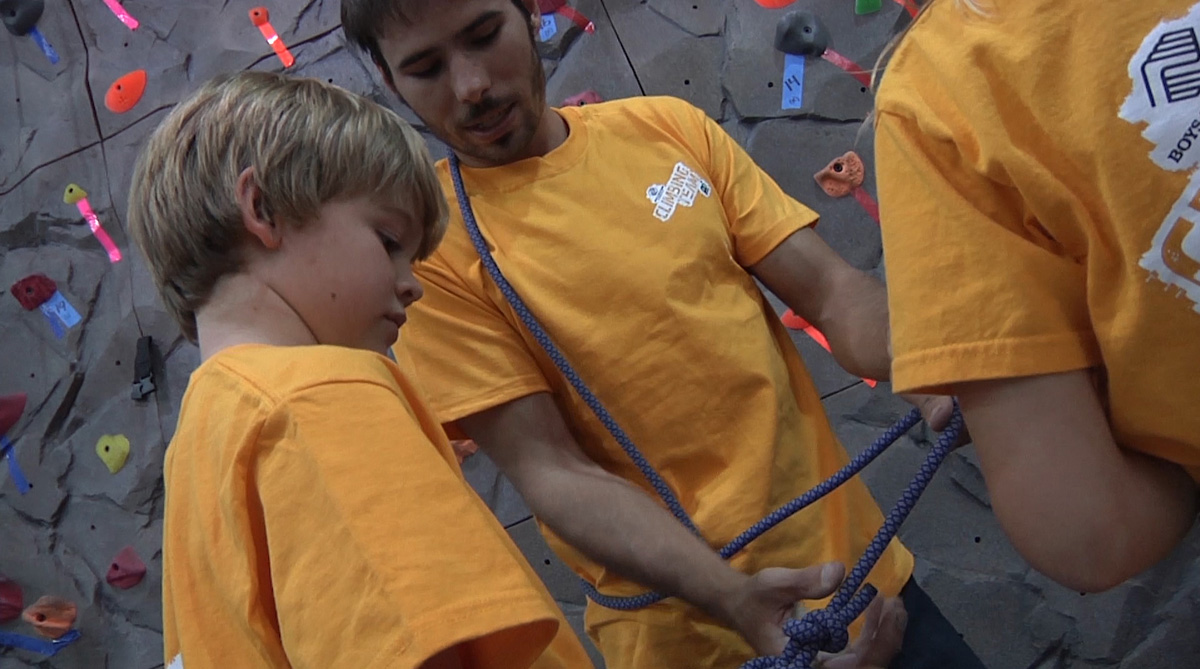 Kevin Jorgeson instructs about climbing to first timers.