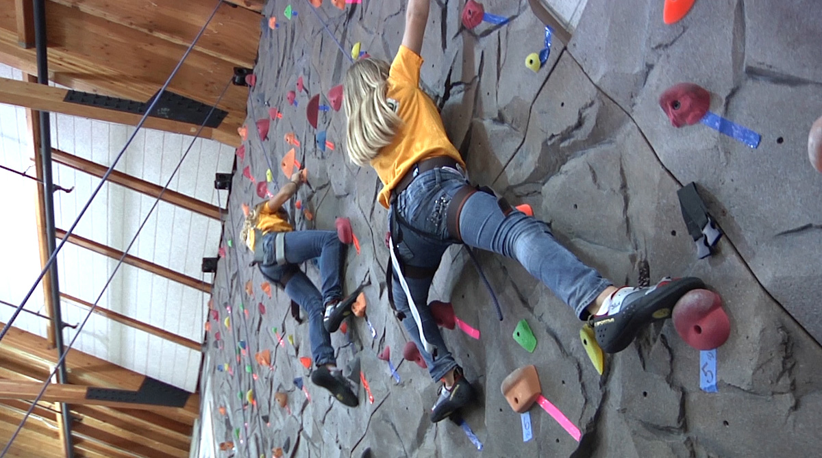 Boys and Girls Club members try climbing for the first time.