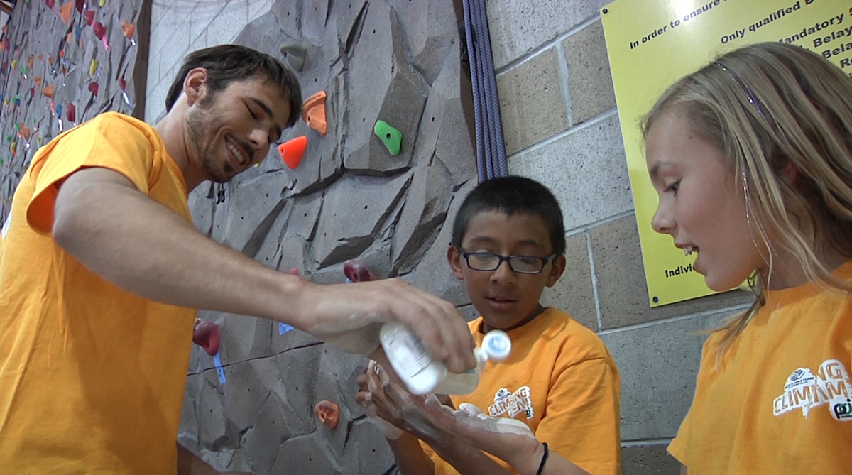 Kevin Jorgeson lets kids try liquid chalk.