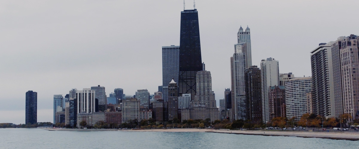 Image of the John Hancock building and Chicago skyline.