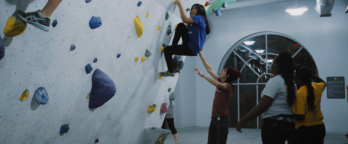 A Chicago Boys and Girls Club member tries climbing for the first time at First Ascent in Chicago.