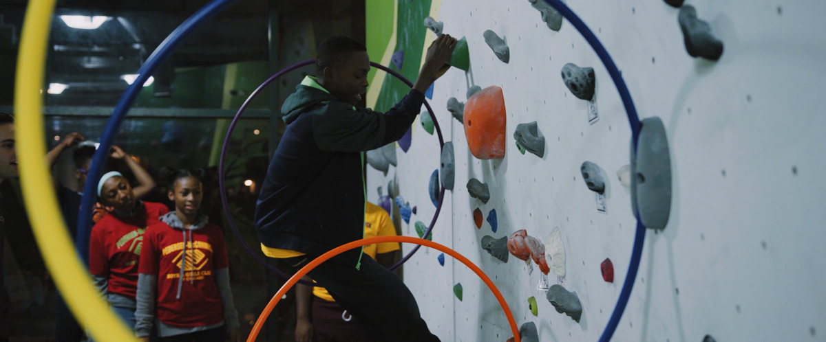 Boys and Girls Clubs members climb through obstacles at First Ascent Climbing Gym.