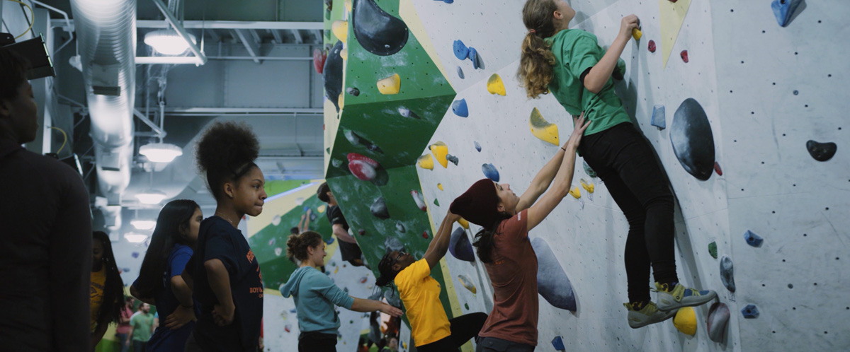 A Chicago Boys and Girls Club member is aided by staff of First Ascent in Chicago.