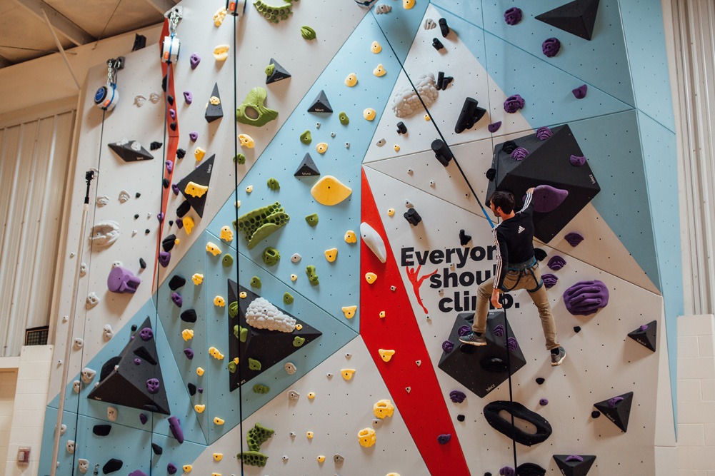 Kevin Jorgeson climbs on the newly constructed Saint Louis Boys and Girls Club wall.
