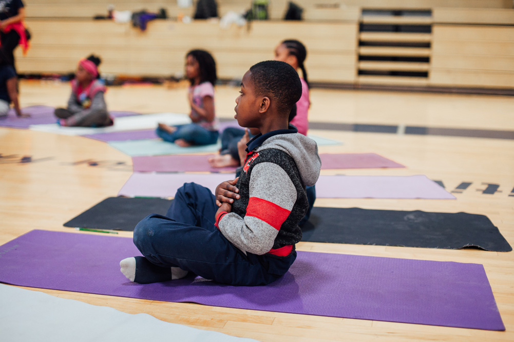 Saint Louis Boys and Girls club members try yoga for the first time.