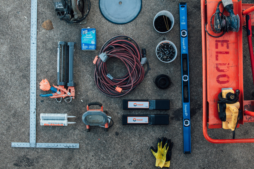 An overhead image of ElDorado climbing wall tools laid out.
