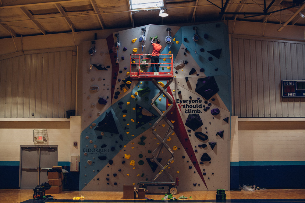 Kevin Jorgeson puts the finishing touches on the Saint Louis Boys and Girls Club climbing wall.