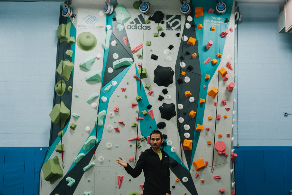 1climb co founder kevin jorgeson is shown in front of the santa rosa 1climb wall