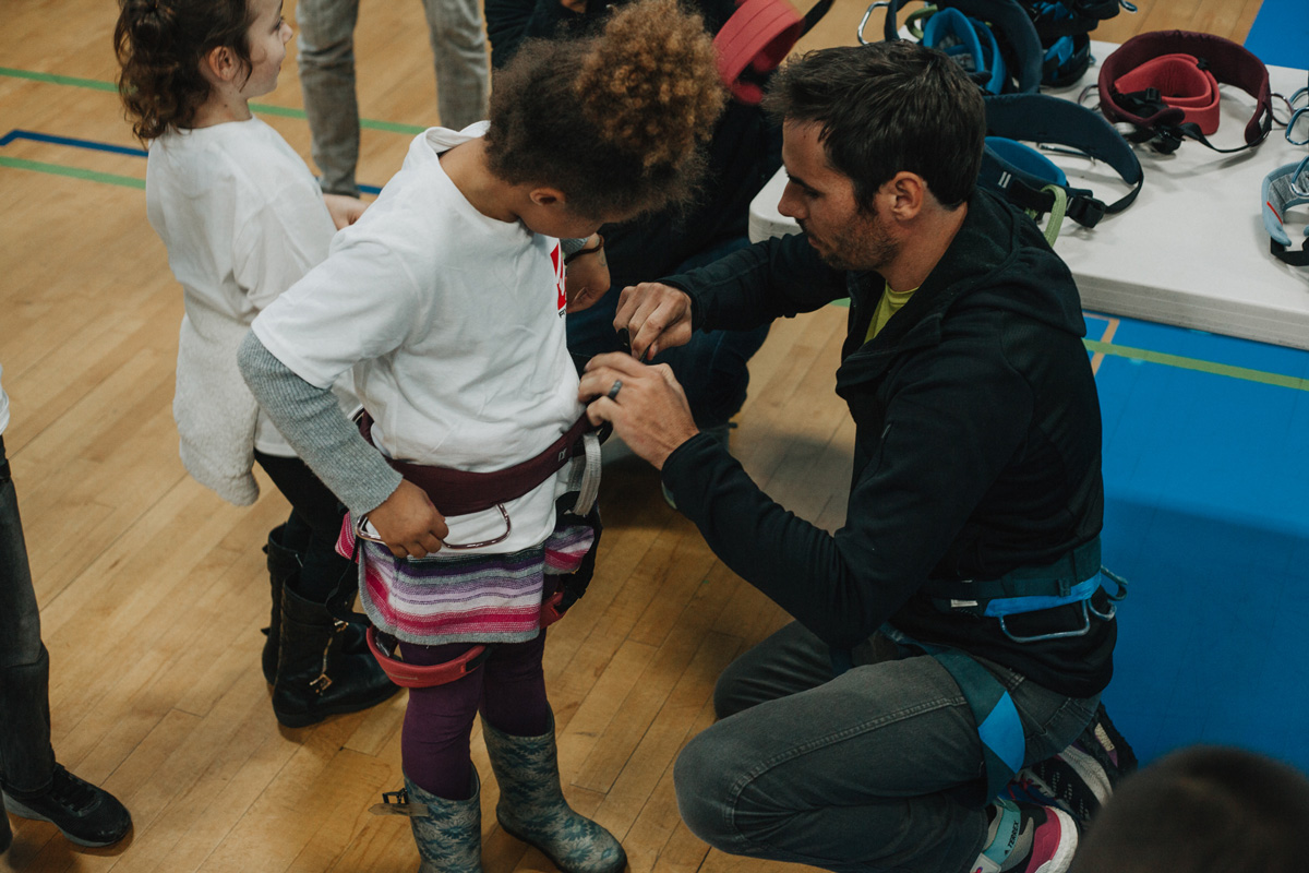 1climb co founder kevin jorgeson helps a boys and girls club member try on a harness