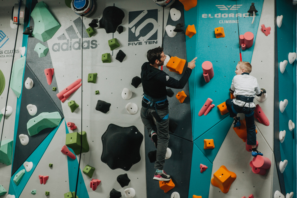 1 climb co founder kevin jorgeson helps a boys and girls club member climb up the new 1climb wall in santa rosa