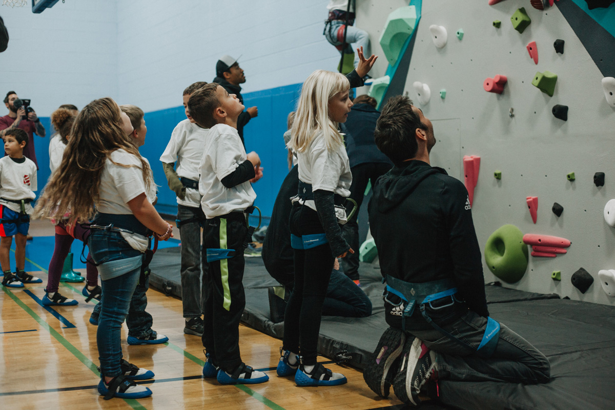 boys and girls club members look up the new 1climb wall in santa rosa