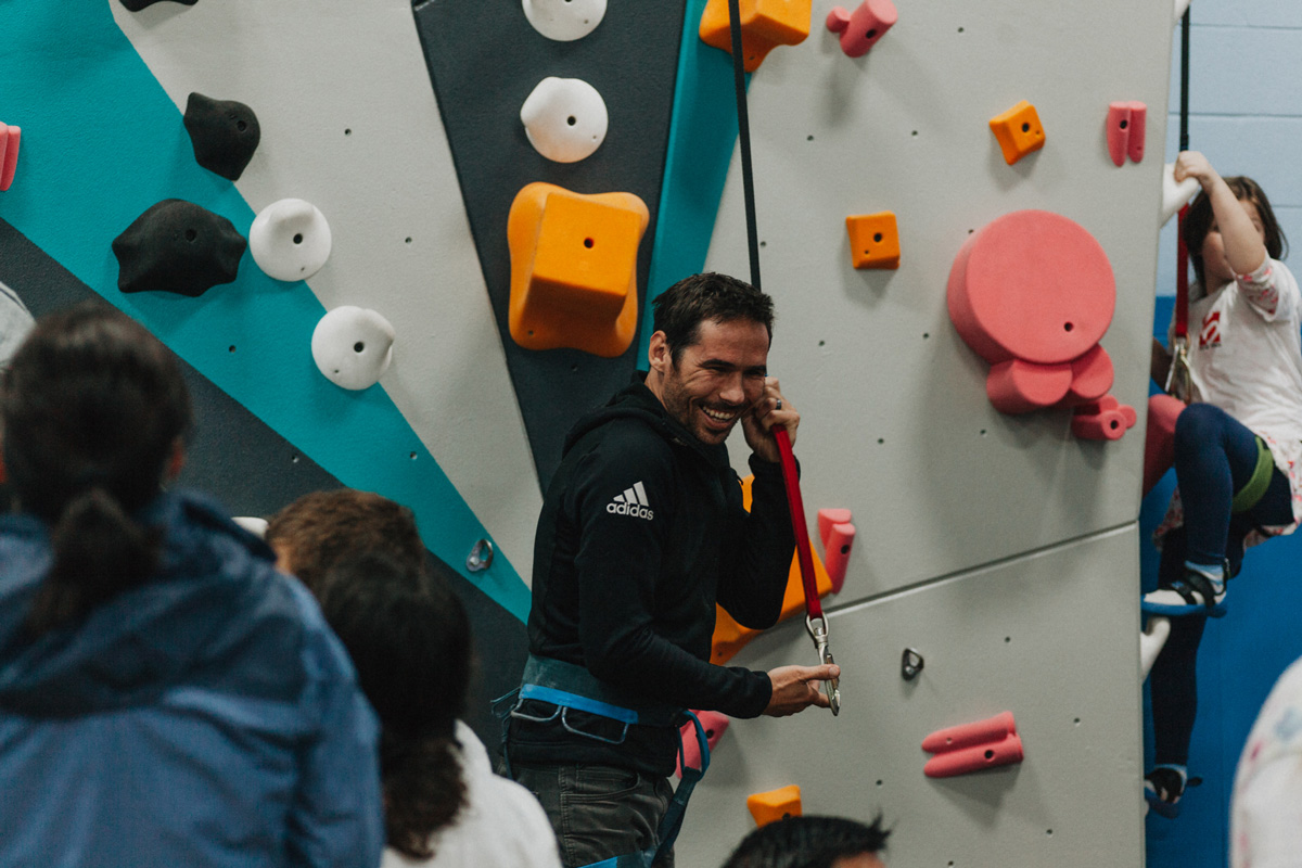 1climb co founder kevin jorgeson pulls an auto belay down to prepare to climb