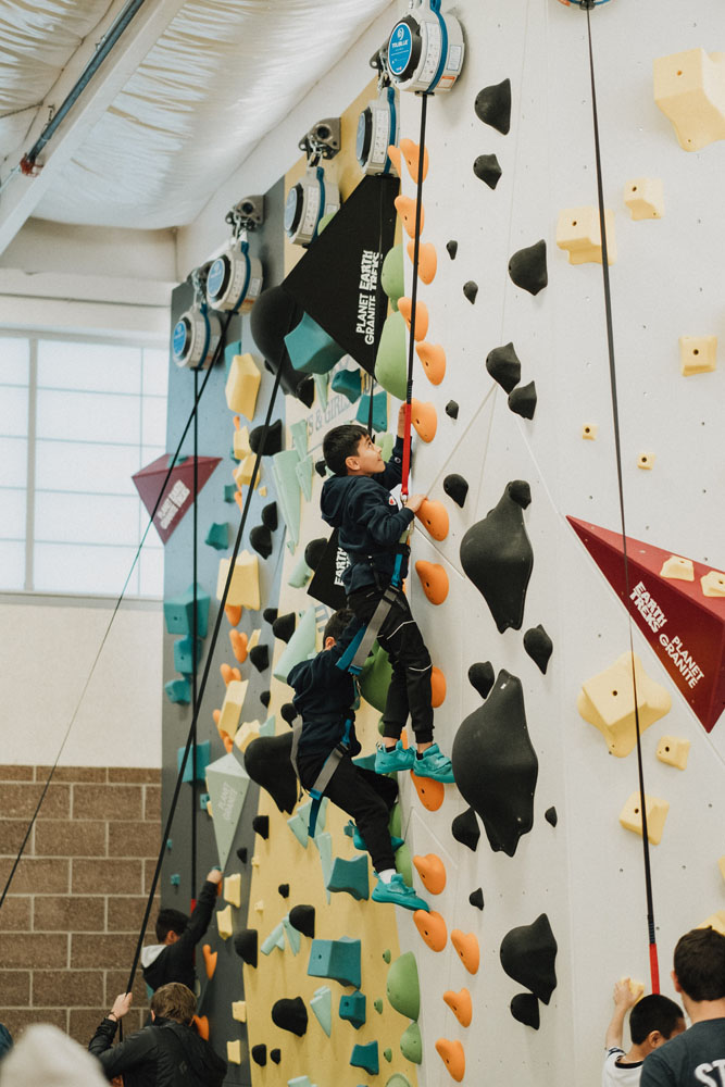 A Boys and Girls Club member climbs for the first time