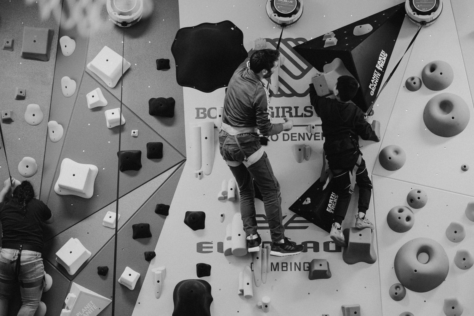 Climber and 1Climb cofounder Kevin Jorgeson helps a Boys and Girls club up the newly constructed Denver 1Climb wall
