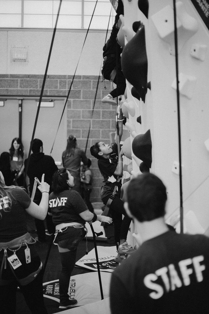 Earth Treks Climbing gym staff help with the new 1Climb climbing wall
