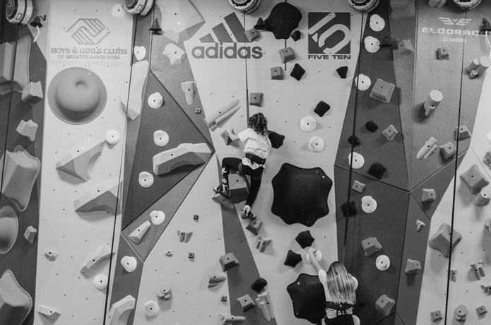 members of the santa rosa boys and girls club climb on the newly installed 1climb wall